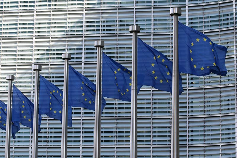 Multiple European Union Flags On Poles