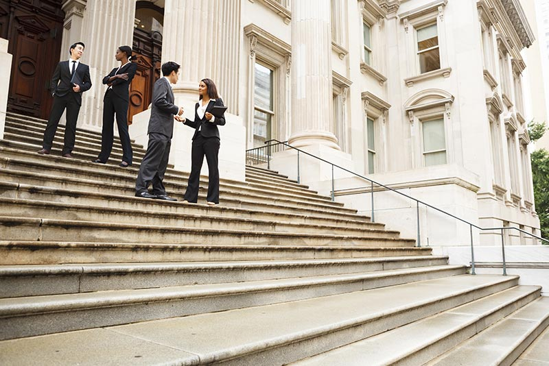 stockphoto businesspeople on stairs of government building