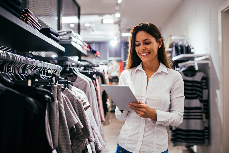 stockphoto woman in retail shop using tablet