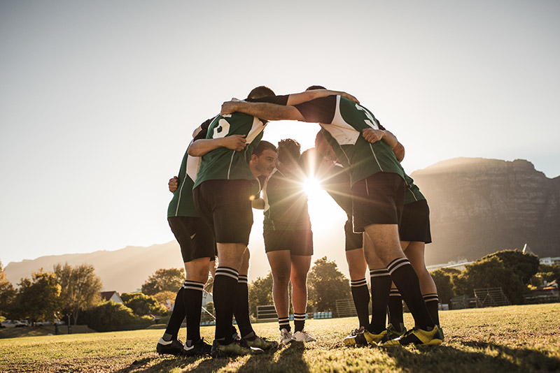 stockphoto sports team in huddle