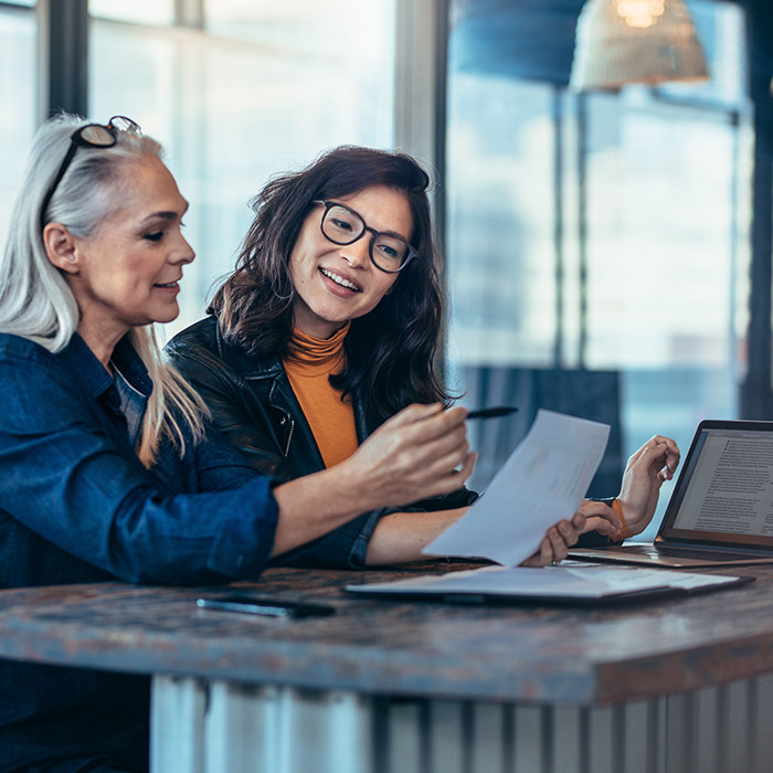 stockphoto two women at counter having discussion